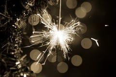 Sparkler on a Christmas tree Royalty Free Stock Photo