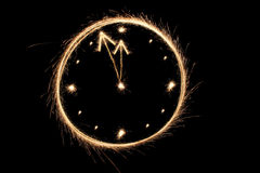 Sparkler clock Royalty Free Stock Images