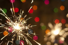 Sparkler and colorful blurred background Royalty Free Stock Photography