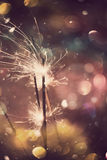 Sparkler and Colorful Bokeh Stock Image