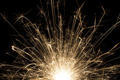 Sparkler in the dark. One sparkler in the dark with black background royalty free stock images