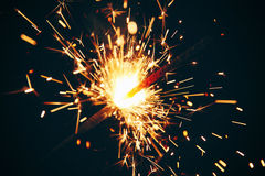 Sparkler on a dark background Royalty Free Stock Photos