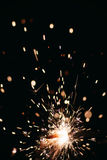Sparkler on a dark background Royalty Free Stock Images