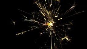 Sparkler on a dark background stock footage