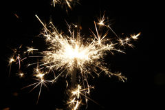 Sparkler. A sparkler in the darkness - symbolic image Royalty Free Stock Photos
