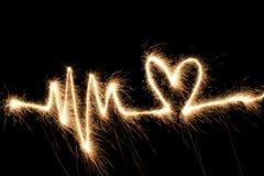 Sparkler de coeur d'onde photos stock