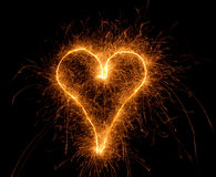 Sparkler drawing heart Royalty Free Stock Images
