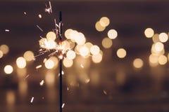 Sparkler e bokeh Imagem de Stock