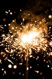 Sparkler with fire particles Royalty Free Stock Photography