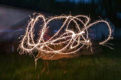 Sparkler Firecracker Fourth of July Girl Stock Photo