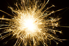 Sparkler firework. Colorful end of traditional sparkler firework igniting with black background stock image