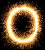 Sparkler firework light alphabet O on black. Background stock photos
