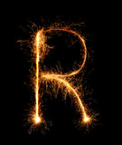 Sparkler firework light alphabet R (Capital Letters) at night Stock Image