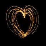 Sparkler firework light with heart shape. Royalty Free Stock Photo