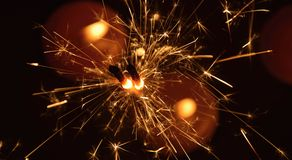 Sparkler fireworks. Sparkler is a symbol of Christmas and New Year Royalty Free Stock Photos