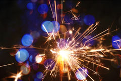 Sparkler on gold bokeh background macro close up. royalty free stock photo