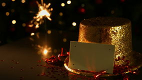 Sparkler beside a golden hat and card stock video footage