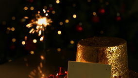 Sparkler beside a golden hat and card stock video