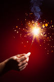 Sparkler in hand Royalty Free Stock Photography