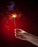 Sparkler in hand Stock Image