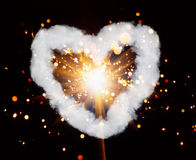 Sparkler and heart smoke ring Stock Image
