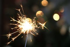 Sparkler. Holiday sparkler with beautiful bokeh Royalty Free Stock Photography