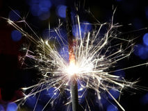 Sparkler making fireworks. Sparkler making white and blue fireworks Royalty Free Stock Image