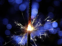 Sparkler making fireworks. Sparkler making white and blue fireworks Royalty Free Stock Photography