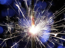 Sparkler making fireworks. Sparkler making white and blue fireworks Royalty Free Stock Photos