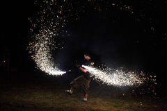 Sparkler man on the grass Stock Photos