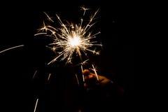 Sparkler. A man holding a burning sparkler in the dark Royalty Free Stock Images
