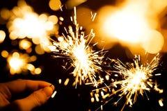 Sparkler. Man's hand holding a sparkler. Blurred background Royalty Free Stock Photos