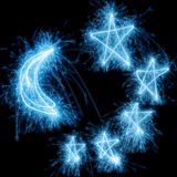 Sparkler moon and stars Royalty Free Stock Photos
