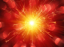 Sparkler on Red Background Stock Photos