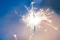 Sparkler in the snow in the evening Stock Images