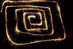 Sparkler spiral square. Trace on black stock photography