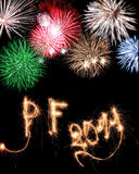 Sparkler text 2011 with fireworks Stock Images