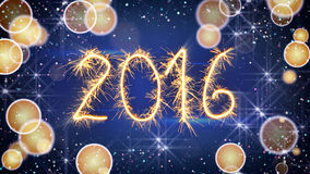 Sparkler text new 2016 year greeting. And blurred lights Royalty Free Stock Photography