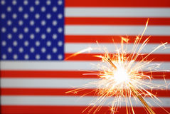 Sparkler on usa flag Stock Photos