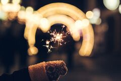 Sparkler and wollen glove Stock Photography