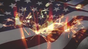 Sparklers with an American flag. Digital composite of sparklers and an American flag waving in the foreground stock video footage