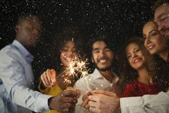 Sparklers background. Young people at celebration party Stock Image