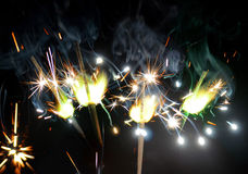 Sparklers. Beautiful festive sparklers on black background Stock Image