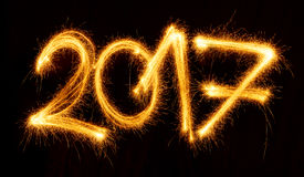 2017 with sparklers on black background. Happy New Year - 2017 with sparklers on black background Stock Photo