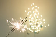 Sparklers and bokeh. Invoking the holidays with sparklers and a light bokeh Stock Photography