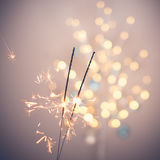 Sparklers and bokeh. Invoking the holidays with sparklers and a light bokeh Royalty Free Stock Images