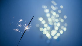 Sparklers and bokeh. Invoking the holidays with sparklers and a light bokeh Royalty Free Stock Photos