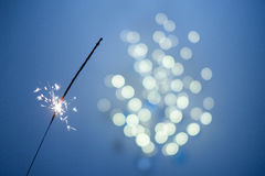 Sparklers and bokeh. Invoking the holidays with sparklers and a light bokeh Royalty Free Stock Photography
