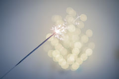 Sparklers and bokeh. Invoking the holidays with sparklers and a light bokeh Stock Photos