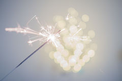 Sparklers and bokeh. Invoking the holidays with sparklers and a light bokeh Stock Images